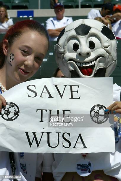 Two girls hold a sign in support of the Women's United Soccer Association before the FIFA 2003 Women's World Cup match between the US and Canada 11...