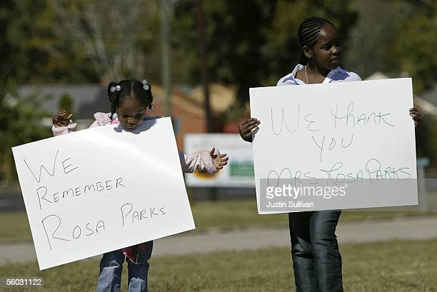Two girls hold signs outide of the St Paul AME Church in honor of civil rights pioneer Rosa Parks October 29 2005 in Montgomery Alabama Parks' body...