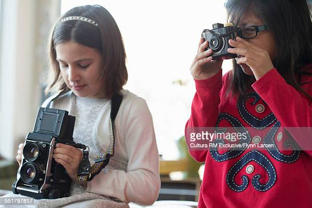 Two girls holding cameras