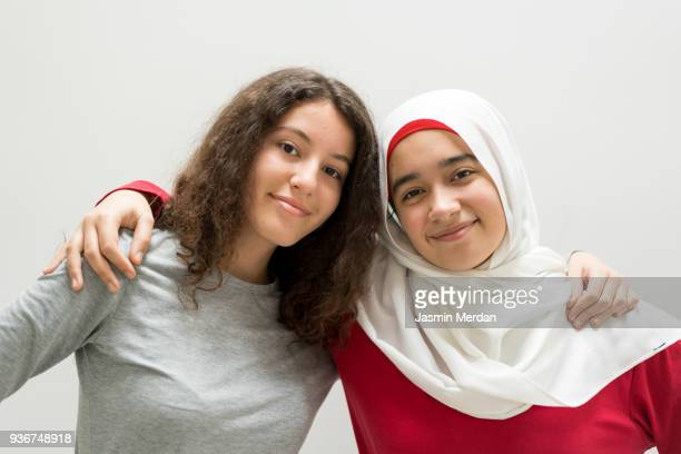 two girls hugging - beautiful turkish girl stock pictures, royalty-free photos & images