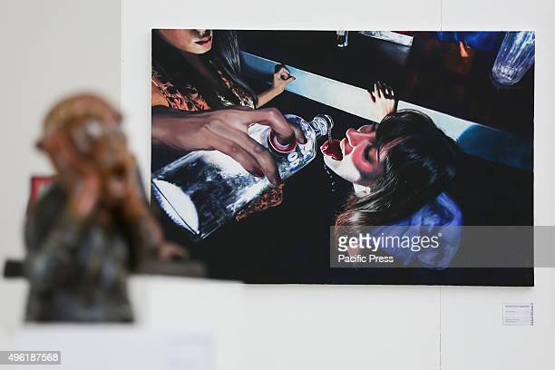 Two girls in a photograph drinking alcohol The Paratissima Exhibition takes place in Turin on its 11th Edition This year's slogan 'Order or Chaos'...