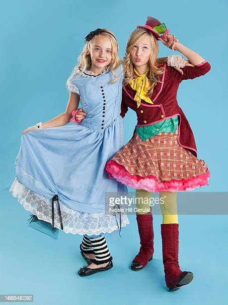 Two girls (10-11) in Alice in Wonderland costumes for Halloween