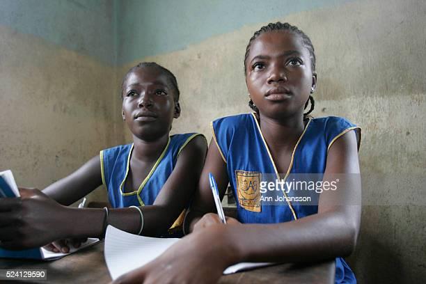 Two girls in class at school in Kenema Sierra Leone