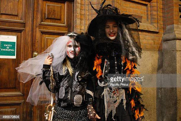 Two girls in costume and make-up celebrate Halloween, an Anglo-Saxon feast celebrated on the night of 31 October, for the streets of downtown.