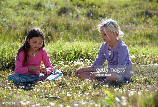 Two girls in field of Spring flowers
