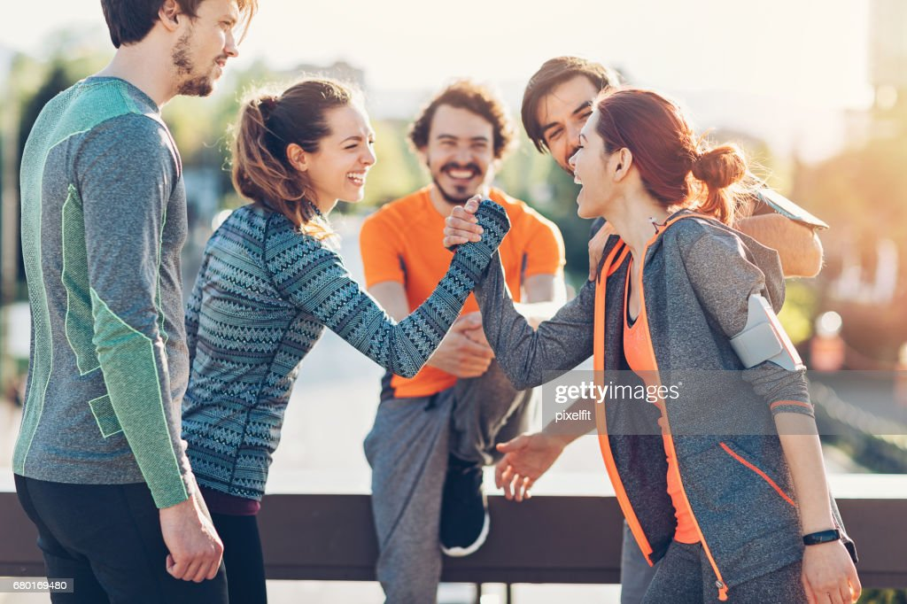 Two girls in fun arm wrestling competition : Stock Photo