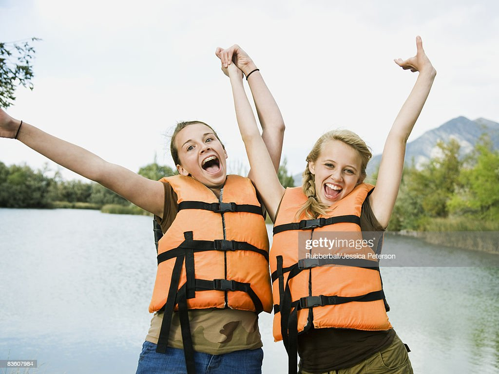 two girls in life vests : Stock Photo