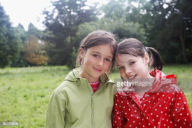 Two Girls in Meadow Getting Wet