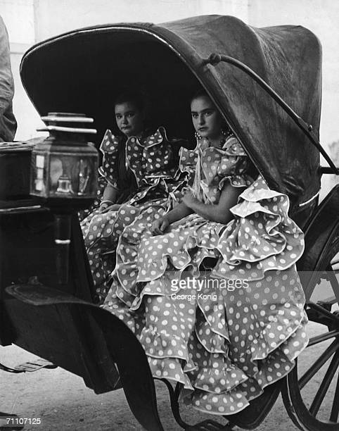 Two girls in polka dot flamenco dresses at the fiesta of the vintage a sherry festival held in Jerez after the grape harvest 29th September 1948