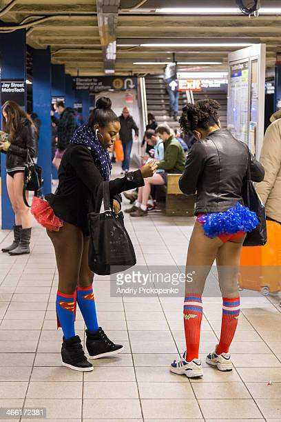 """Two girls in superman socks standing on the platform of Jay Street - Metro Tech Station in NYC during the """"No Pants Subway Ride"""" on January 12"""