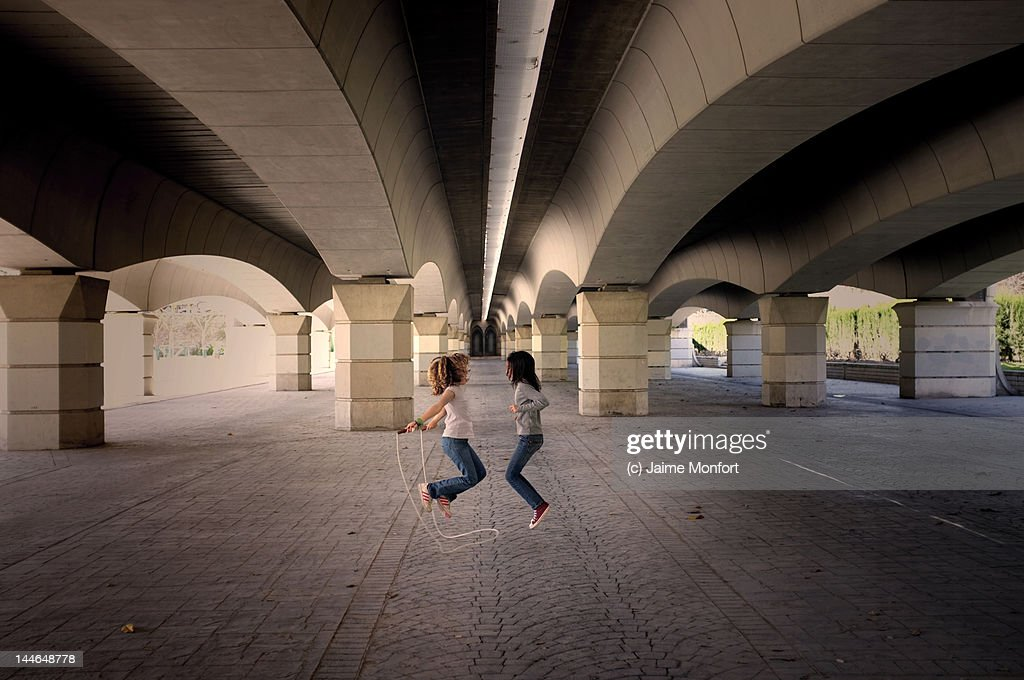 Two girls jumping rope : Stock Photo