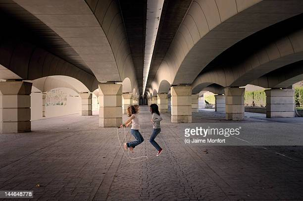 Two girls jumping rope