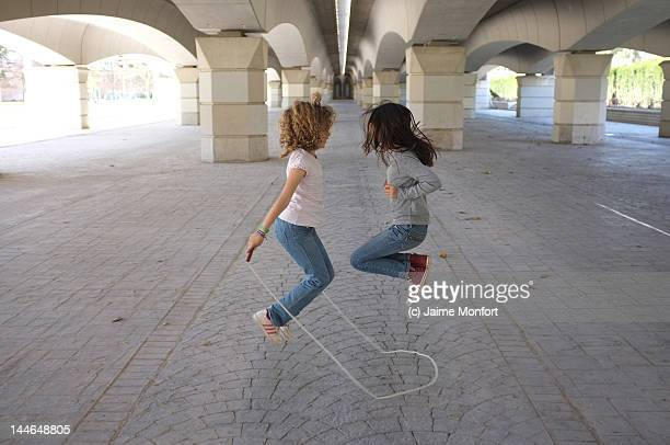 two girls jumping rope - skipping rope stock pictures, royalty-free photos & images