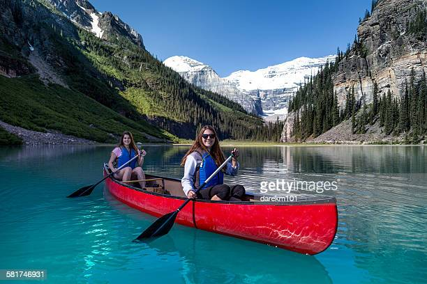 Two girls kayaking, Lake Louise, Banff National Park, Alberta, Canada