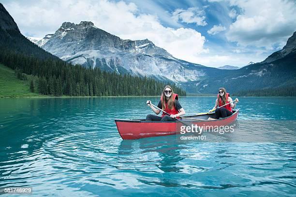 Two girls kayaking, Yoho National Park, British Columbia, Canada