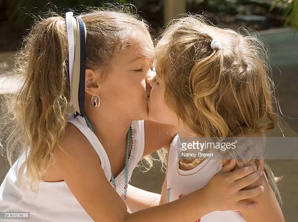 Two girls (2-5) kissing