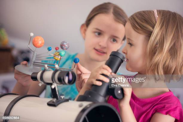Two girls learning about space and astronomy