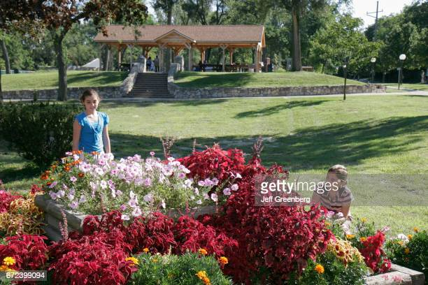 Two girls looking at flowers in Washington Park