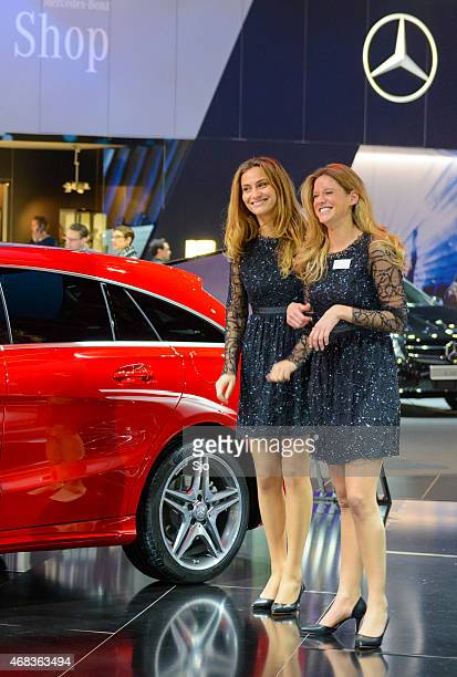 Two girls looking at the Mercedes CLA Shooting Brake