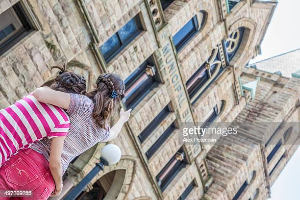 Two girls looking to Lackawanna County Courthouse Square, Pennsylvania, USA