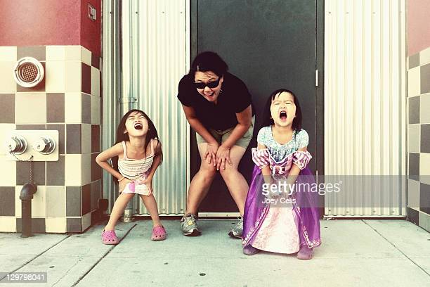 Two girls making silly faces on street