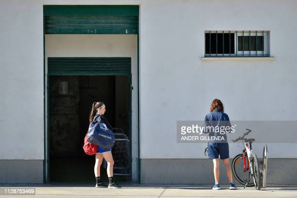 Two girls of Anorga KKE football school arrive for a training session in the Spanish Basque city of San Sebastian on February 18 2019