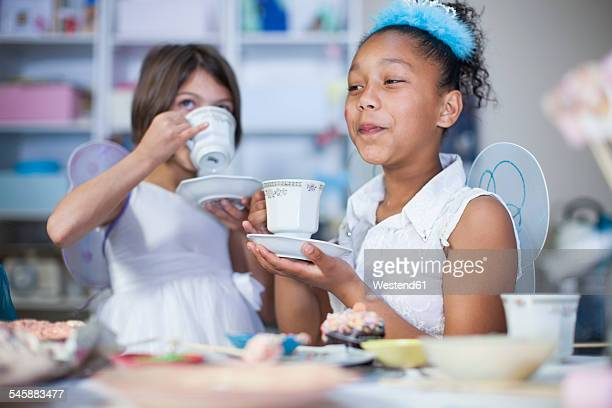 Two girls on a tea party