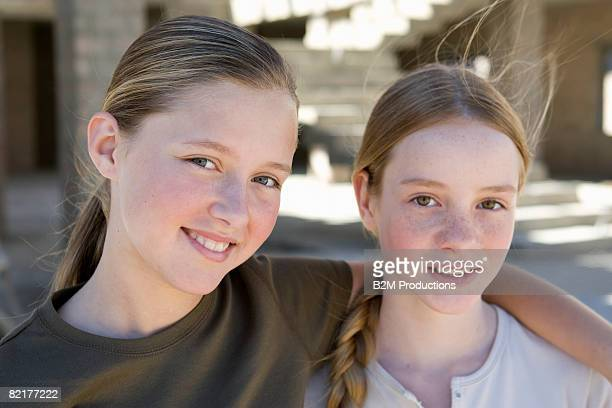 two girls (11-12 years) on construction site - 12 13 years stock pictures, royalty-free photos & images
