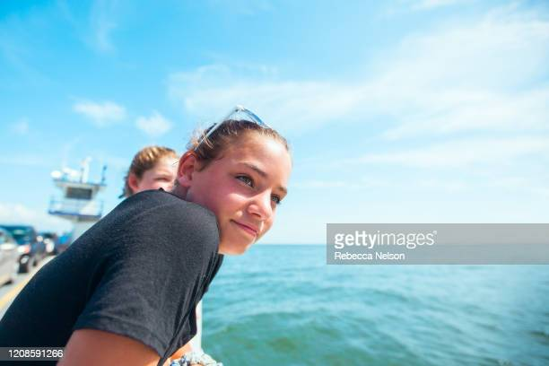 two girls on ferry boat - ferry stock pictures, royalty-free photos & images