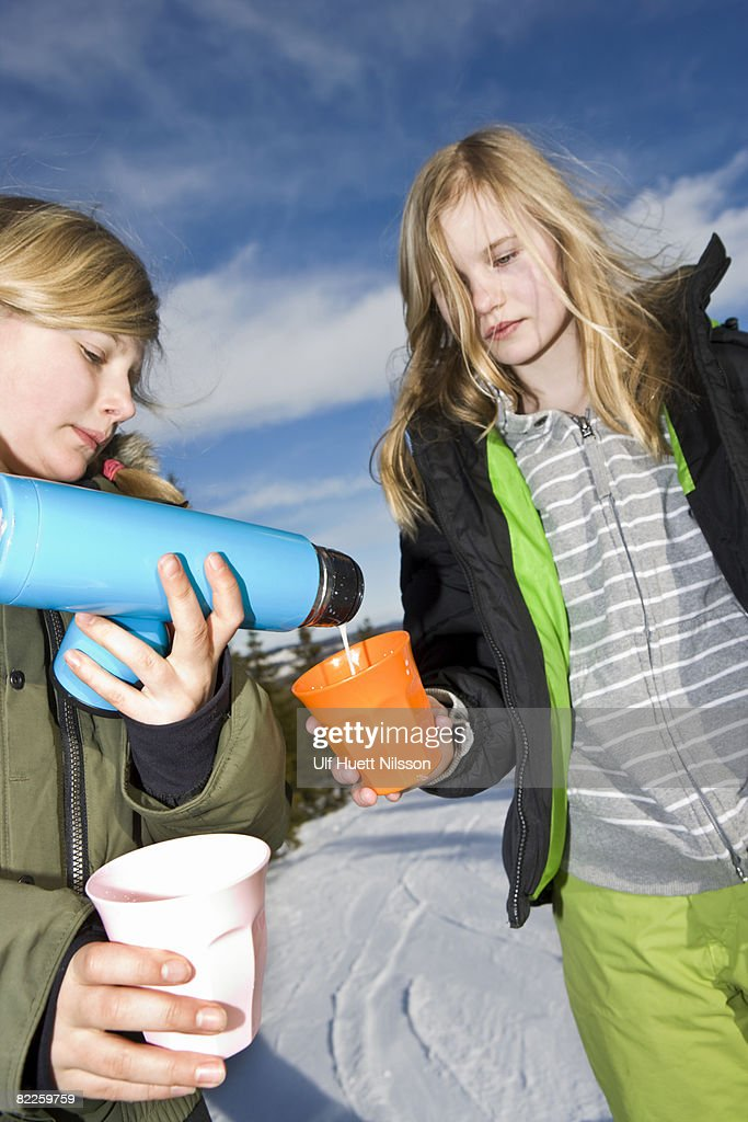 Two girls on ski vacation Sweden. : Stock Photo