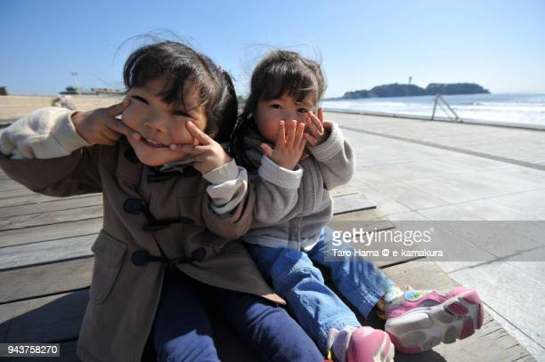 Two girls on the beach in Fujisawa in Japan