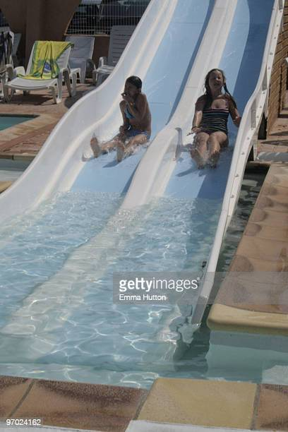 two girls on waterslide - hutton stock photos and pictures