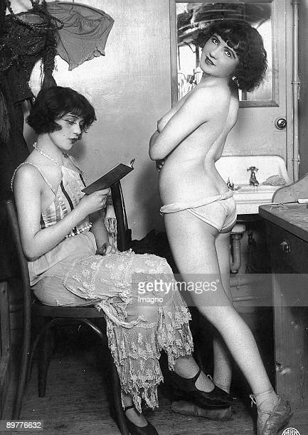 Two Girls One naked one with a book Photograph around 1930