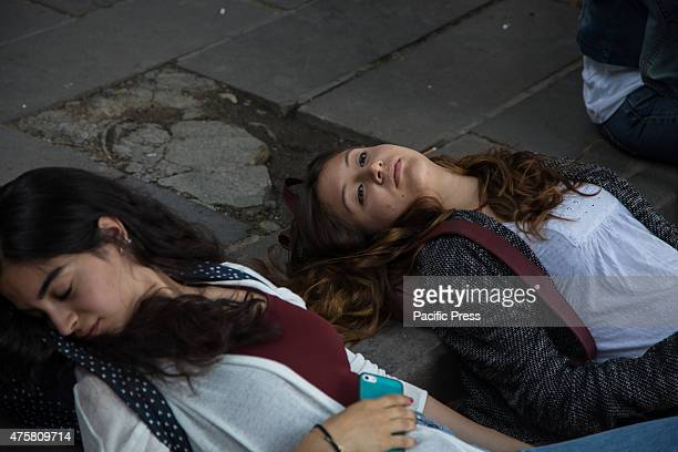 Two girls play dead near the spot of Kizilay square where Ethem Sarisülük was shot on June 1 2013 at the exact time of the incident