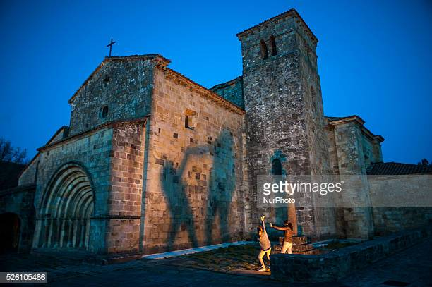 Two girls play make shadows on the outside of the church of Santa Cruz in Castañeda , on January 24, 2016. The Collegiate Church of Santa Cruz is...