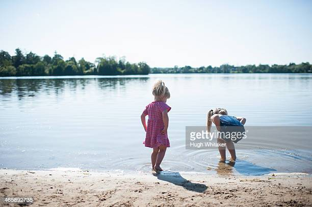 two girls playing by lake - peterborough ontario stock photos and pictures