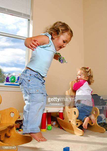 two girls playing - little girls bare bum stock pictures, royalty-free photos & images