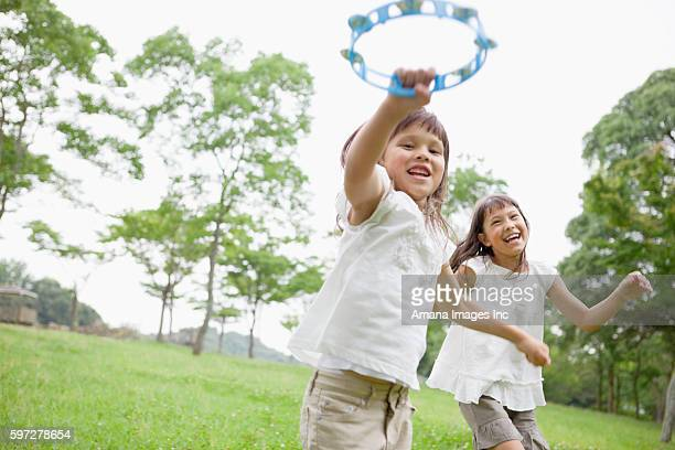 Two Girls Playing Tambourines
