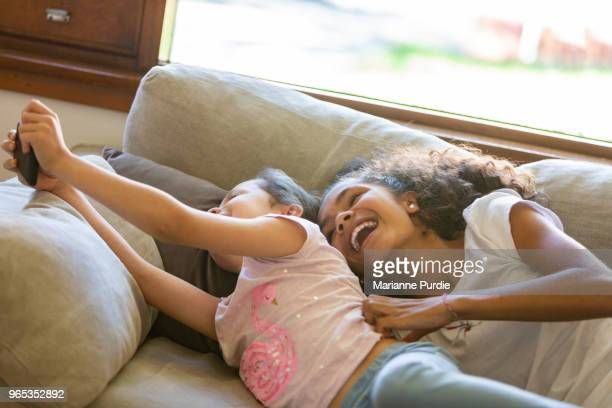 Two girls playing with a smart phone