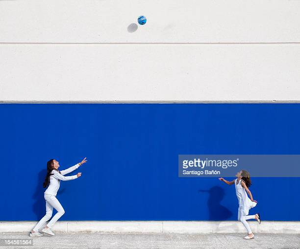 two girls playing with ball - catching stock pictures, royalty-free photos & images