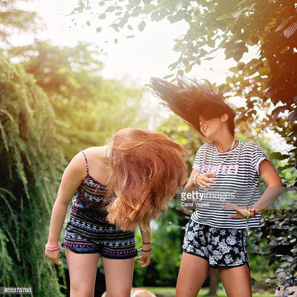 Two Girls playing with hair
