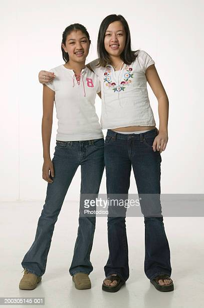 two girls (12-13), portrait - girl wear jeans and flip flops stock photos and pictures