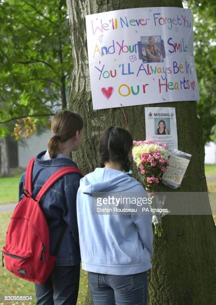 Two girls read a tribute pinned to a tree in Walton on Thames where Milly Dowler disappeared More than 100 specialist search officers were combing...