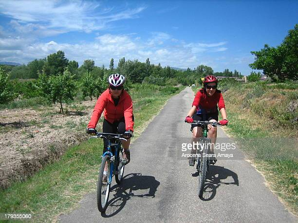 Two girls riding on Cidacos Green Trail, in La Rioja. Vías Verdes, or Green Trails, are old, unused railway tracks that have been converted into...