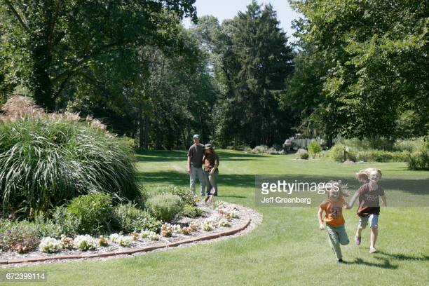 Two girls running in International Friendship Gardens