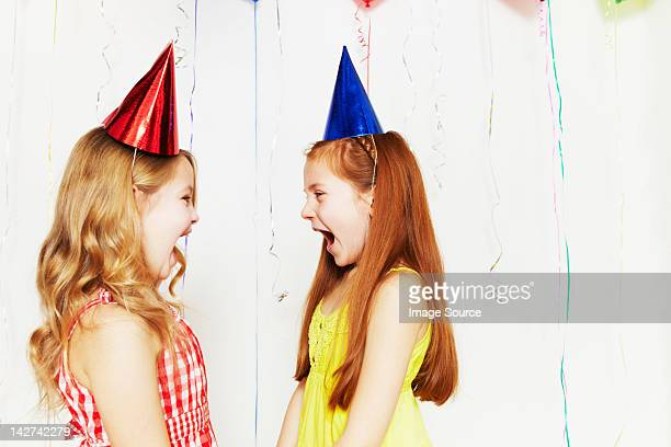Two girls screaming at each other
