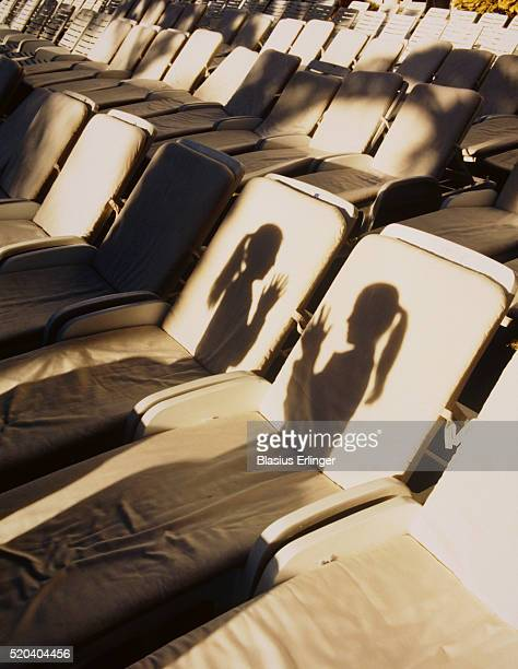 two girls' shadows on deck chairs - blasius erlinger stock pictures, royalty-free photos & images