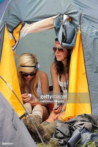 Two girls shelter from the sun in their tent during during day two of the Glastonbury Music Festival at Glastonbury Festival site on June 26 2009 in...