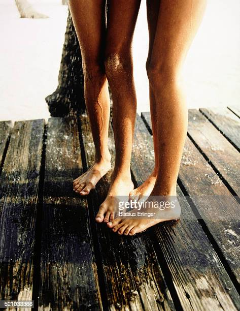 two girls showering outside - blasius erlinger stock pictures, royalty-free photos & images