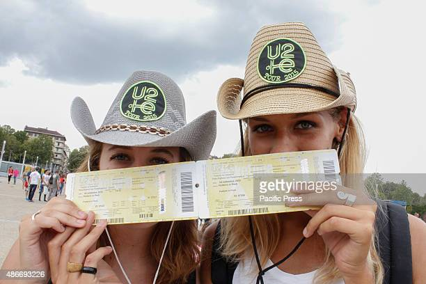 Two girls showing their tickets for the U2's concert Growing expectations for the first of only two Italian dates of 'U2 Innocence Experience Tour...